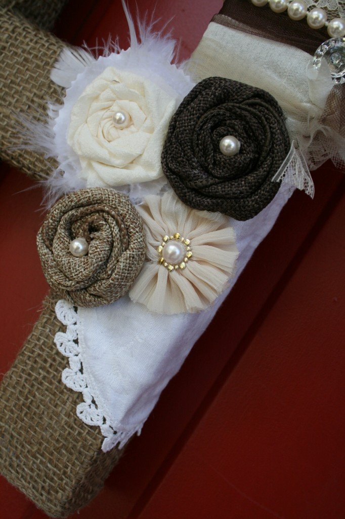from pinterest to projects detail of fabric flowers and doily added to the burlap wrapped mixed media front door decor alpha letter