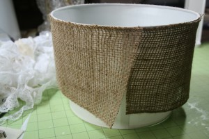 step one of diy lamp makeover project using burlap