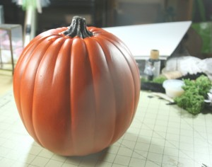 foam pumpkins painted for halloween with black paint and covered with mica flecks and sealed with clear coat poly for decorations