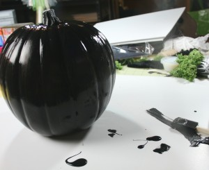 oam pumpkins painted for halloween with black paint and covered with mica flecks and sealed with clear coat poly for decorations