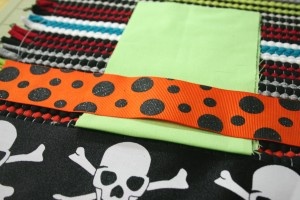 taking fabric rug to create and craft a handmade halloween placemat using fabritac fabric glue ribbon and fabric