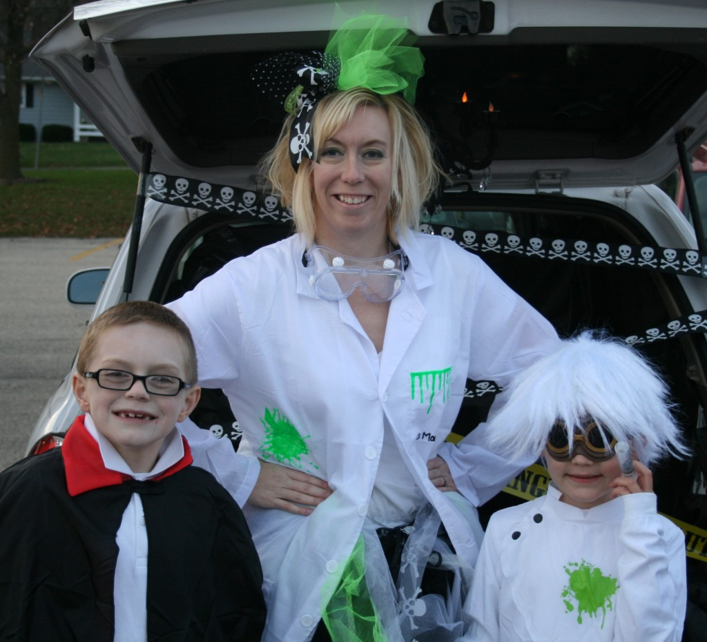 halloween mad scientist test tubes and beakers with slime made at home using tulip paint and ilovetocreate products