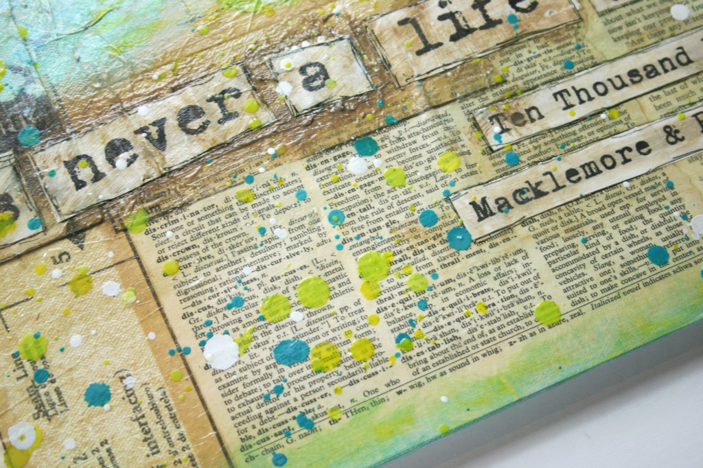 mixed media canvas using old book pages, decopauge, paint, gesso, melted crayons, sharpie, and quote