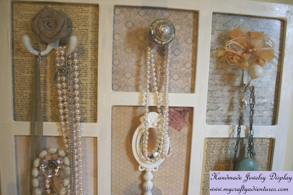 mixed media repurposed photo frame upcycling to a jewelry display using old hooks pulls and knobs paint heat guns decopauge glue