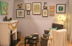 living room scene with art wall for Fiskars booth at cha