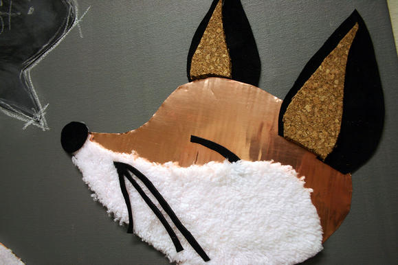 mixed media fox created with faux fur, cop[er flashing, leather, cork, canvas, paint, and chalk