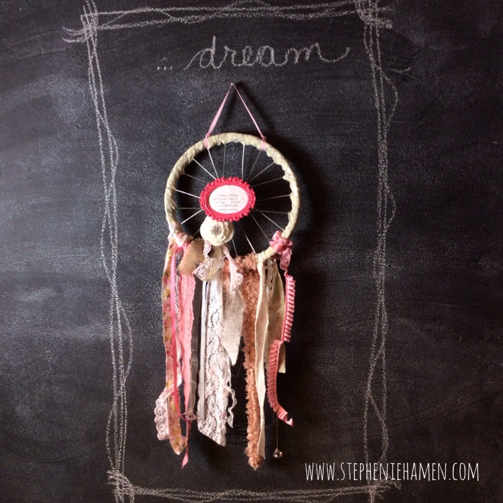 Dream catcher from upcycled bike rim, vintage lace, fabrics, and trims with bling and flowers dream a little dream of me quote