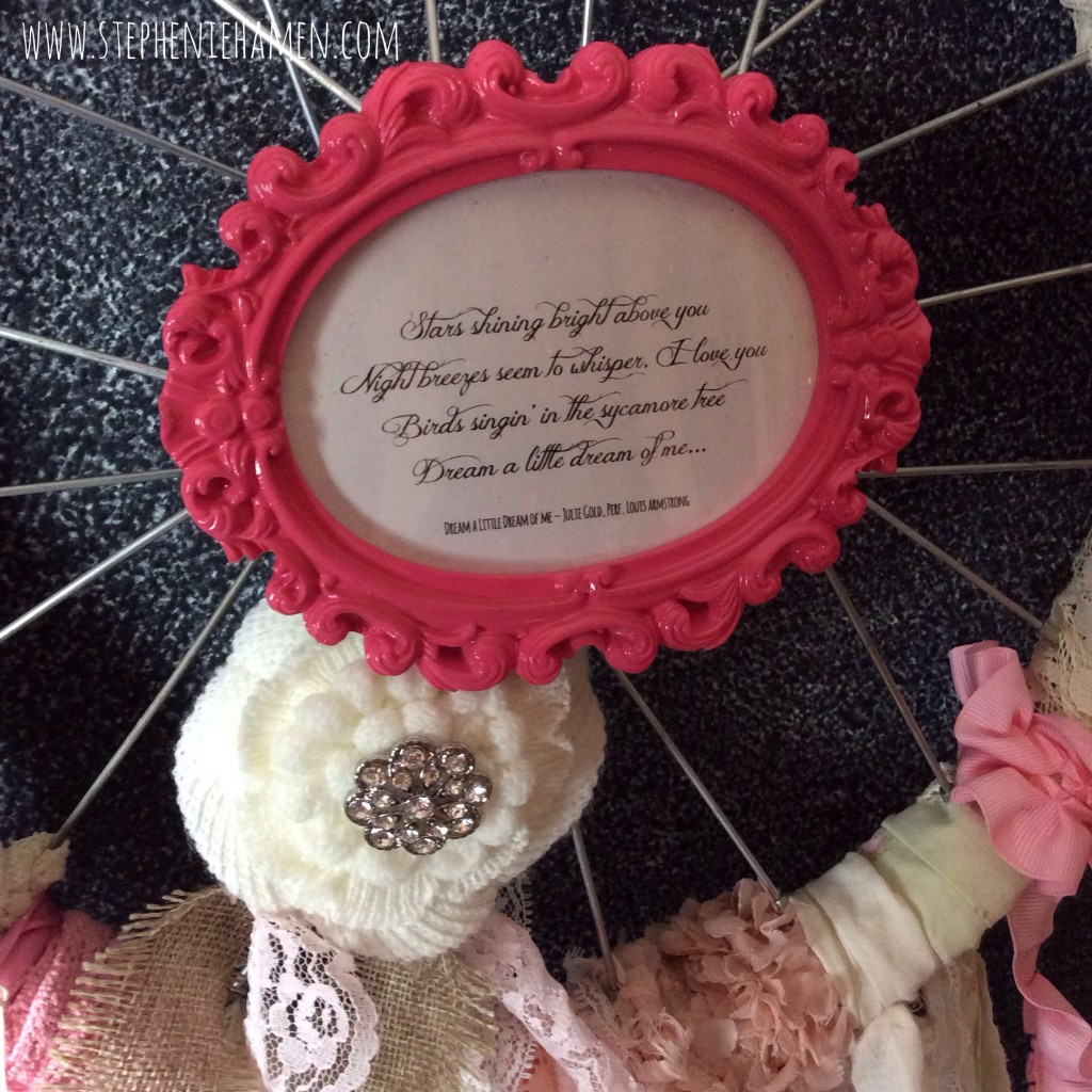 Dream catcher from upcycled bike rim, vintage trims, lace,fabric and bling dream a little dream of me quote
