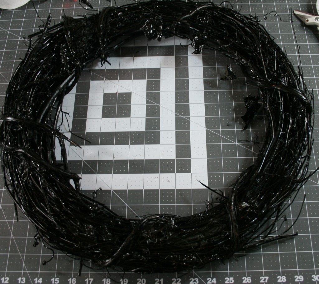 Halloween wreath with black paint