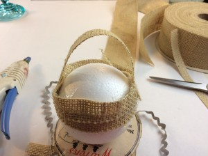starting to build the bottom of the acorn ornament with burlap strips diy how to tutorial