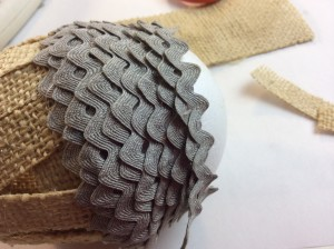 wrapping rickrack and gluing it to create the cap of the acorn ornament