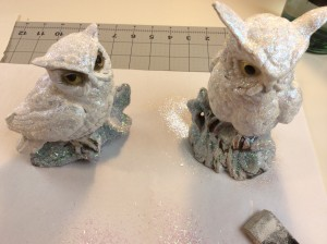 glitter and decoupage drying on the owls