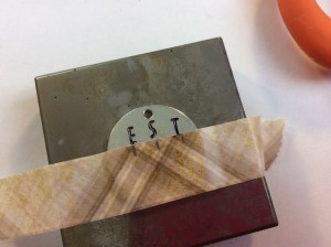 Stamping letters on metal