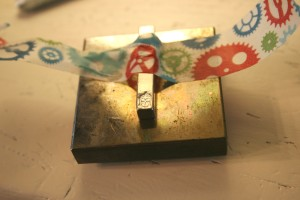buddah stamped into the side of the breathe pendant with impressart stamps